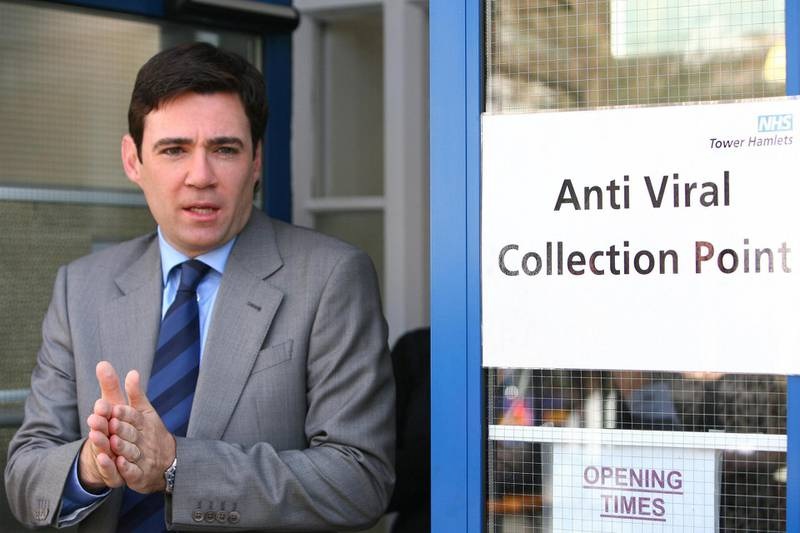 LONDON - JULY 20:  Health Secretary, Andy Burnham rubs disinfectant gel onto his hands after visiting an anti-viral clinic in Tower Hamlets on July 20, 2009 in London, England. Mr Burnham was told how the centre in Tower Hamlets, which dispenses the anti-viral drug Tamiflu, had drawn in volunteers from other areas of the health trust to help it see more than 400 patients a day suffering from swine flu.  (Photo by Johnny Green/WPA-Pool/Getty Images)