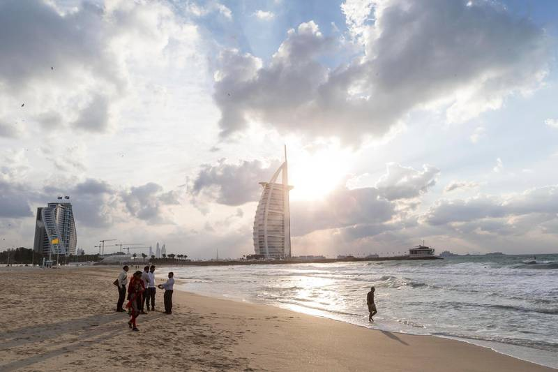 DUBAI, UNITED ARAB EMIRATES, 08 DECEMBER 2015. Visitors enjoy the windy weather on Sunset Beach in Dubai. STANDALONE (Photo: Antonie Robertson/The National) ID: None. Journalist: None. Section: National. *** Local Caption ***  AR_0812_Standalone-01.JPG