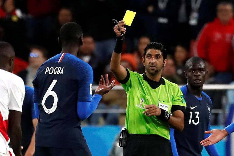 Soccer Football - World Cup - Group C - France vs Peru - Ekaterinburg Arena, Yekaterinburg, Russia - June 21, 2018   France's Paul Pogba is shown a yellow card by referee Mohammed Abdulla Hassan Mohamed    REUTERS/Damir Sagolj