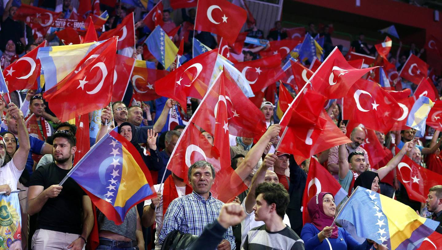epa06752819 Supporters of Turkish President Recep Tayyip Erdogan wave flags during an election campaign rally of his Justice and Development Party (AK Party) in Sarajevo, Bosnia and Herzegovina, 20 May 2018. Some 10,000 supporters gathered to attend the AKP's rally ahead of the 24 June snap elections in Turkey. The presidential and parliamentary elections were originally scheduled to be held in November 2019, but government has decided the change the date. About three million Turks living abroad are eligible to vote in the election.  EPA/FEHIM DEMIR