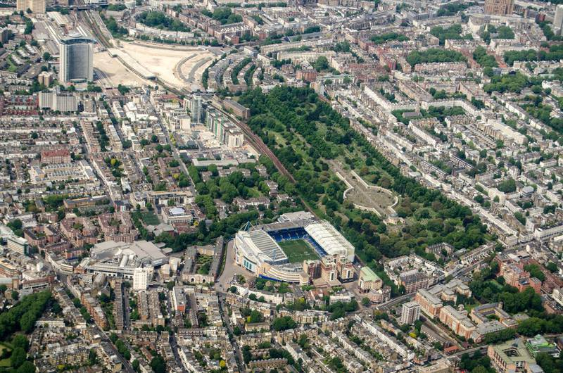 2AK2PEG Aerial view looking north across Chelsea and Earls Court with the Stamford Bridge Stadium - home to Chelsea Football Club and Brompton Cemetary in the