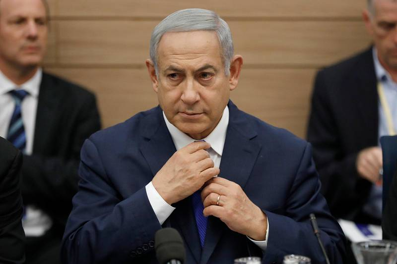 epa07176684 Israeli Prime Minister Benjamin Netanyahu as he listens to the Foreign Affairs and Defense Committee for the first time as Minister of Defense of Israel in the Israeli Knesset, (Israeli Parliament), in Jerusalem, 19 November 2018. Media reports state that the Netanyahu government will not go to early elections after Naftali Bennett and Ayelet Shaked of the Jewish Home Party decided not to resign from the coalition. The elections are scheduled to take place in November 2019  EPA/ABIR SULTAN