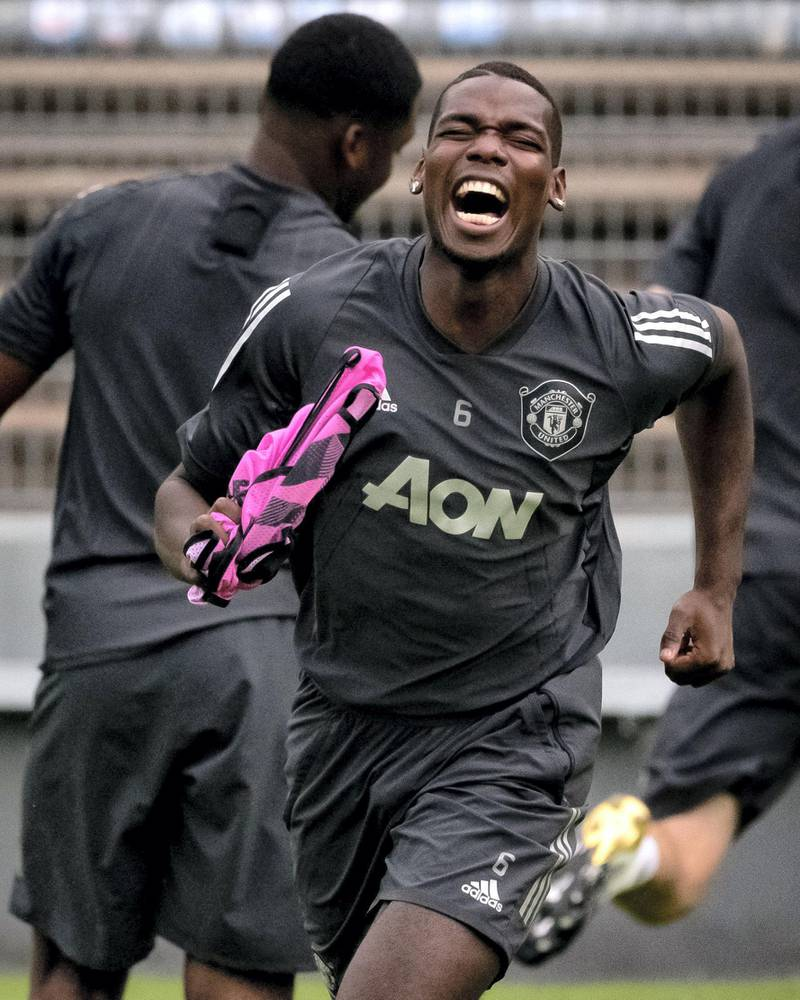 COLOGNE, GERMANY - AUGUST 15:  Paul Pogba of Manchester United  laughs during a training session at RheinEnergieStadion on August 15, 2020 in Cologne, Germany. (Photo by Ash Donelon/Manchester United via Getty Images)