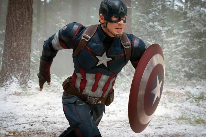 """FILE - This file photo provided by Disney/Marvel shows Chris Evans as Captain America/Steve Rogers, in the new film, """"Avengers: Age Of Ultron."""" Evans suggested his run as Captain America is done. The filmmakers controlling the Avengers' fates say he shouldn't shelve the shield just yet. (Jay Maidment/Disney/Marvel via AP)"""