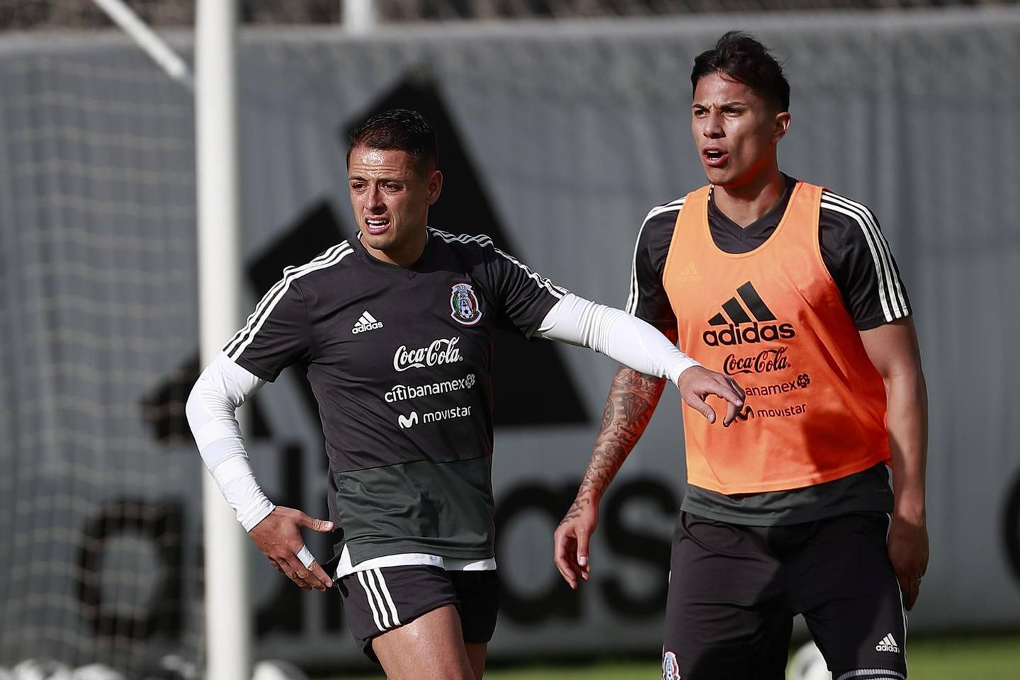 epa06779546 Mexican soccer players Javier Hernandez (L) and Carlos Salcedo (R) train with their team at the High Performance Center in Mexico City, Mexico, 01 June 2018. The Mexican national soccer team will play a friendly match against Scotland at the Azteca stadium on 03 June 2018.  EPA/JOSE MENDEZ