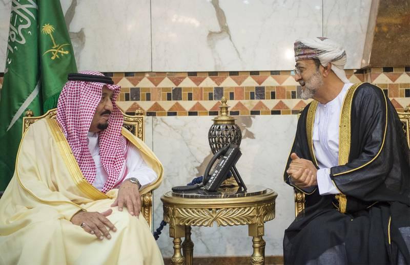 RIYADH, SAUDI ARABIA - NOVEMBER 13: Saudi Arabia's King Salman Bin Abdulaziz (L) meets Minister of Heritage and Culture in the Sultanate of Oman Haitham bin Tariq Al Said (R) to receive condolences after one of his brothers Saudi Prince Turki bin Abdulaziz Al Saud passed away, in Riyadh, Saudi Arabia on November 13, 2016. (Photo by Pool / Bandar Algaloud/Anadolu Agency/Getty Images)