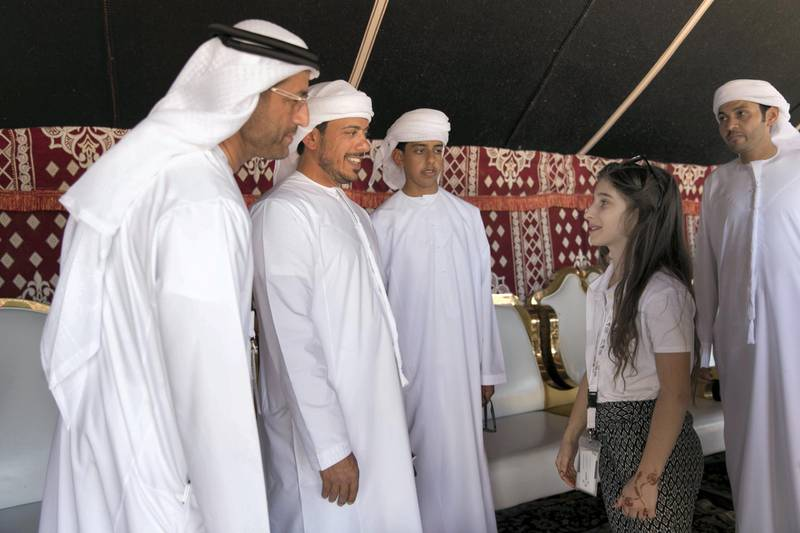 ABU DHABI, UNITED ARAB EMIRATES - DEC 6, 2017  Sheikh Sultan Bin Tahnoon Al Nehyan meets Sandra Moravcíková, a 10 year old falconer from Slovakia, at the fourth International Festival of Falconry.   This gathering is a tribute to a similar meeting 41 years ago, in 1976, when the UAE Founding Father Sheikh Zayed invited falconers from around the world to convene in the desert of Abu Dhabi and build a strategy for the sport's development.  (Photo by Reem Mohammed/The National)  Reporter: Anna Zacharias Section: NA