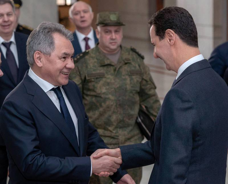 epa07448916 A handout photo made available by the official Syrian Arab News Agency (SANA) shows Syrian President Bashar Assad (R) receiving Russian Defense Minister Sergey Shoygu (L), Damascus, Syria, 19 March 2019. According to SANA, Assad said the Russian-Syrian coordination, especially in the military and political domains, were one of the decisive factors of Syrias steadfastness in the face of terrorism.  EPA/SANA HANDOUT  HANDOUT EDITORIAL USE ONLY/NO SALES