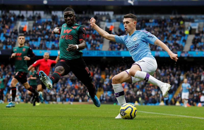 """Soccer Football - Premier League - Manchester City v Aston Villa - Etihad Stadium, Manchester, Britain - October 26, 2019  Manchester City's Phil Foden in action with Aston Villa's Marvelous Nakamba  REUTERS/Phil Noble  EDITORIAL USE ONLY. No use with unauthorized audio, video, data, fixture lists, club/league logos or """"live"""" services. Online in-match use limited to 75 images, no video emulation. No use in betting, games or single club/league/player publications.  Please contact your account representative for further details."""