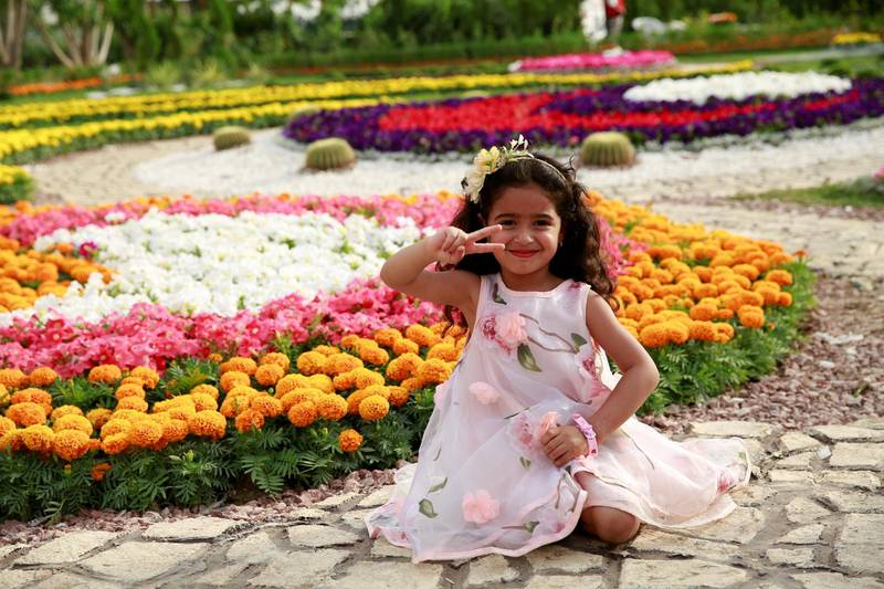 """BAGHDAD, IRAQ - APRIL 28: People visit 9th Flower Festival named """"Flower, Culture and Vixtory"""" at al-Zawra Park in Baghdad, Iraq on April 28, 2017. (Photo by Haydar Hadi/Anadolu Agency/Getty Images)"""
