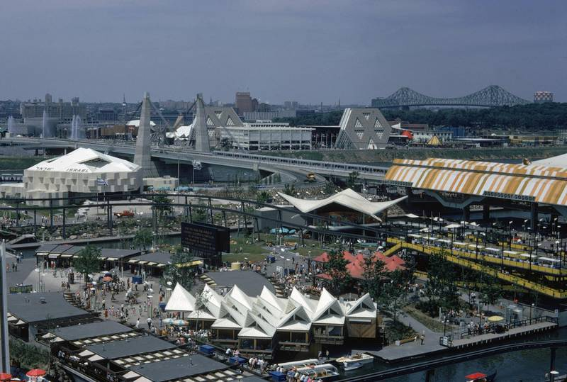 Aerial view of the 1967 Expo fairgrounds in Montreal, Canada, 1967. A monorail runs throughout the middle of the fairgrounds, next to the Place D'Accueil entranceway (center). To the left is the Israeli pavillion. In the background to the top right are the prominant hexagonal structures and Jacques Cartier Bridge.  (Photo by Harvey Meston/Getty Images)