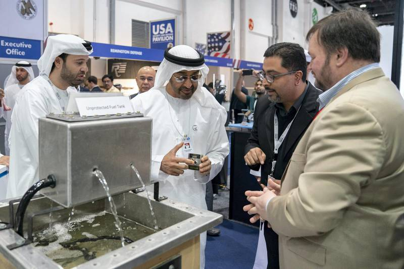 ABU DHABI, UNITED ARAB EMIRATES - February 18, 2019: HH Sheikh Mohamed bin Zayed Al Nahyan, Crown Prince of Abu Dhabi and Deputy Supreme Commander of the UAE Armed Forces (2nd L) tours the 2019 International Defence Exhibition and Conference (IDEX), at Abu Dhabi National Exhibition Centre (ADNEC).  ( Mohamed Al Hammadi / Ministry of Presidential Affairs ) ---