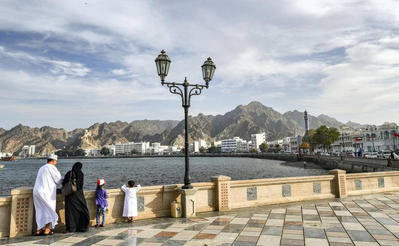 An Omani family stands by the waterfront in the Mutrah area of the capital Muscat on November 16, 2018. (Photo by GIUSEPPE CACACE / AFP)