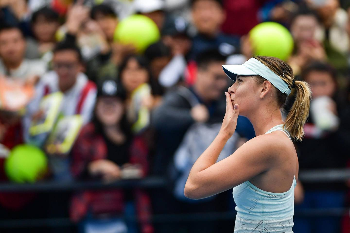 Maria Sharapova of Russia blows a kiss to the crowd after her victory over Mihaela Buzarnescu of Romania in the first round of the Shenzhen Open tennis tournament in Shenzhen, in China's southern Guangdong province on January 1, 2018. / AFP PHOTO / - / China OUT