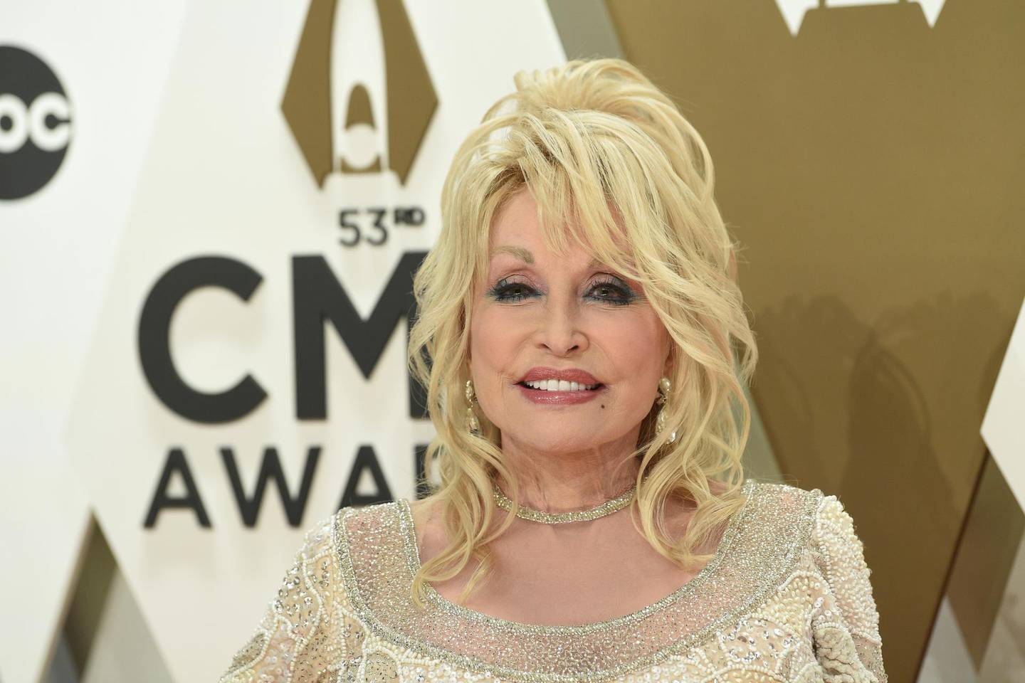 """File-This Nov. 13, 2019, file photo shows Dolly Parton arriving at the 53rd annual CMA Awards at Bridgestone Arena in Nashville, Tenn. Parton's new Netflix series """"Heartstrings"""" will tell a host of stories when it premieres on Friday. One will put the spotlight on Parton's home and people in the mountains of East Tennessee. The series debuts on the streaming platform with eight episodes each telling a story based on one of Parton's songs.(Photo by Evan Agostini/Invision/AP, File)"""