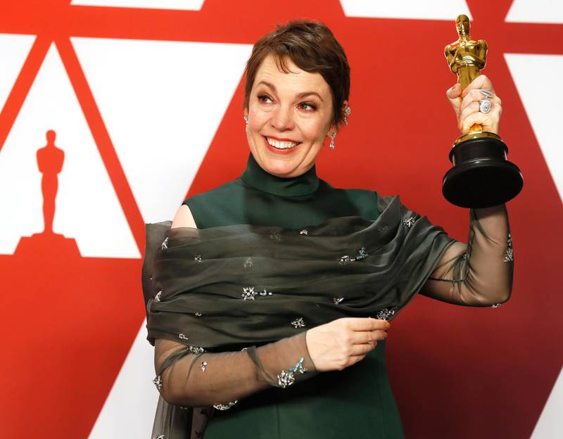 epa07395388 Olivia Colman holds her award for Actress in a Leading Role for 'The Favourite;' as she poses in the press room during the 91st annual Academy Awards ceremony at the Dolby Theatre in Hollywood, California, USA, 24 February 2019. Green dress by Prada, jewels by Chopard. The Oscars are presented for outstanding individual or collective efforts in 24 categories in filmmaking.  EPA-EFE/ETIENNE LAURENT