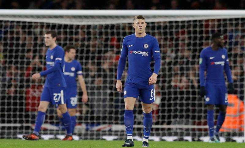 Chelsea's Ross Barkley stands after Arsenal's Granit Xhaka scored his side second goal during the English League Cup semifinal second leg soccer match between Chelsea and Arsenal at the Emirates stadium in London, Wednesday, Jan.24, 2018. (AP Photo/Matt Dunham)