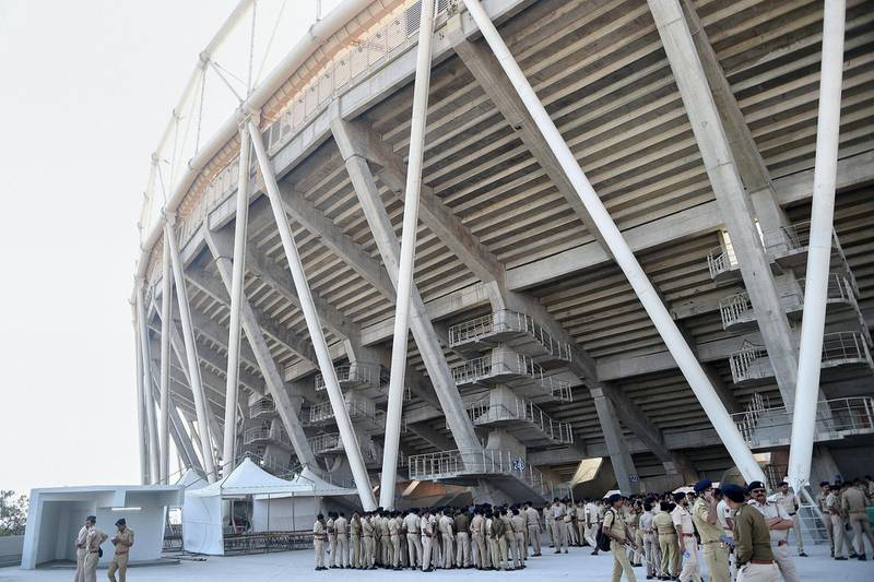 Police personnel gather in the campus of Sardar Patel Stadium, in Motera, on the outskirts of Ahmedabad, on February 21, 2020. - US President Donald Trump will open the world's biggest cricket stadium in India next week, but critics wonder whether it's just another vanity project by Prime Minister Narendra Modi in his home state. (Photo by SAM PANTHAKY / AFP)