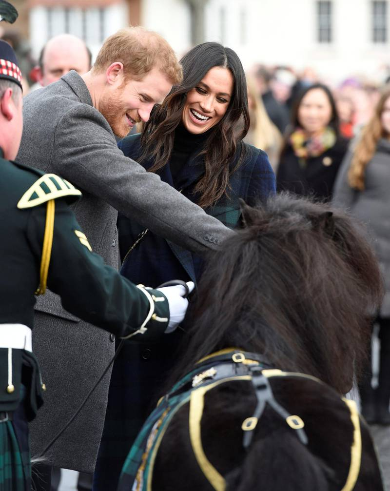 Prince Harry and Meghan Markle meet Pony Major Mark Wilkinson and regimental mascot Cruachan IV during a walkabout on the esplanade at Edinburgh Castle, while on their visit to Scotland.