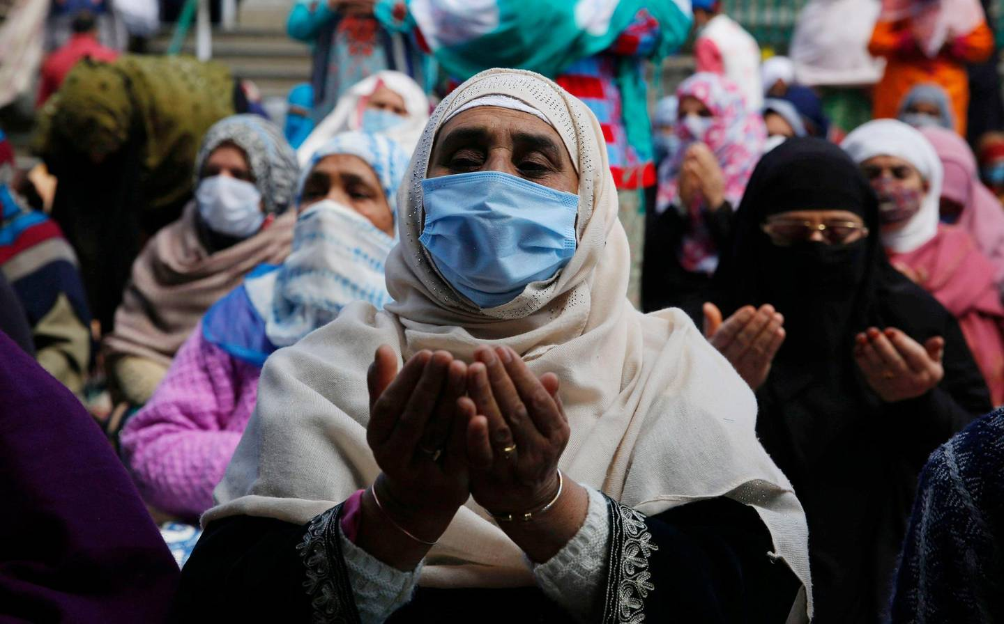 epa09145098 Kashmiri Muslim women pray during holy month of Ramadan outside shrine in Srinagar, the summer capital of Indian Kashmir, 19 April 2021. Muslims around the world celebrate the holy month of Ramadan by praying during the night time and abstaining from eating, drinking, and sexual acts during the period between sunrise and sunset. Ramadan is the ninth month in the Islamic calendar and it is believed that the revelation of the first verse in Koran was during its last 10 nights.  EPA/FAROOQ KHAN