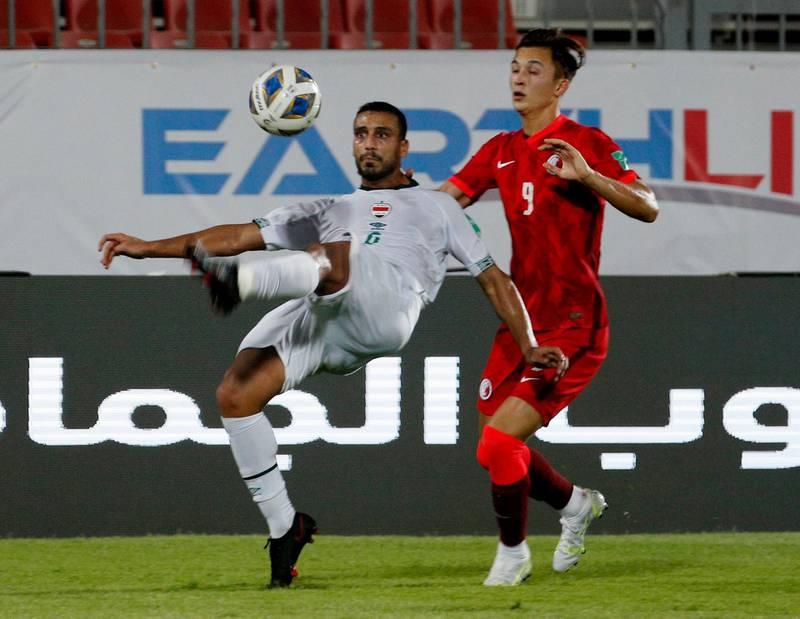 Soccer Football - World Cup - Asia Qualifiers - Second Round - Group C - Hong Kong v Iraq - Al Muharraq Stadium, Al Muharraq, Bahrain - June 11, 2021 Iraq's Ali Adnan in action with Hong Kong's Matthew Orr REUTERS/Hamad I Mohammed