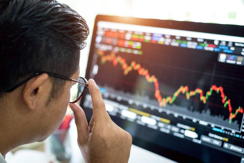 businessman analysis stock market . Getty Images