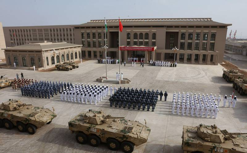 This photo taken on August 1, 2017 shows Chinese People's Liberation Army personnel attending the opening ceremony of China's new military base in Djibouti.  China has deployed troops to its first overseas naval base in Djibouti, a major step forward for the country's expansion of its military presence abroad. / AFP PHOTO / STR / China OUT
