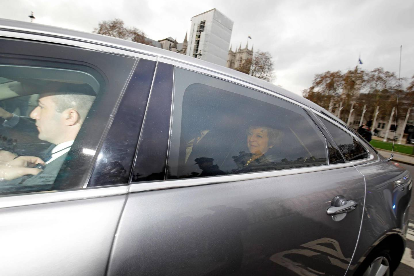 """Britain's Prime Minister Theresa May reacts as she is driven into the House of Commons in central London on December 12, 2018 ahead of the weekly question and answer session, Prime Ministers Questions (PMQs). British Prime Minister Theresa May was hit by a no-confidence motion by her own party on December 12 over the unpopular Brexit deal she struck with EU leaders last month. Facing her biggest crisis since assuming office a month after Britons voted in June 2016 to leave Europe, May vowed to fight the coup attempt inside her own Conservative Party """"with everything I've got"""".  / AFP / Tolga AKMEN"""