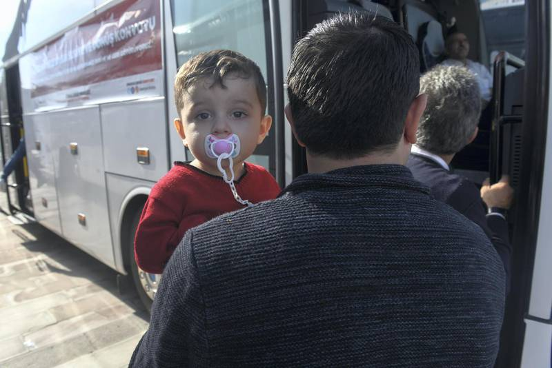 A one hundred and forty three Syrian refugees volunteered to return their homelands Jarablus,Damascus,Aleppo,A'zaz,Al Bab,Afrin load their belongings to trunks of the buses and wait for departure from Istanbul in Esenyurt Municipality garden.          EMRAH GUREL