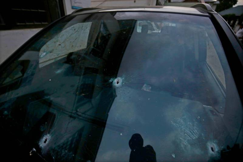 epa06807657 A view of bullet holes in the windshield of the vehicle in which Shujaat Bukhari, senior journalist and Editor-in-Chief of English daily 'Rising Kashmir,' was killed in a militant attack at Press Colony in Srinagar, the summer capital of Indian Kashmir, 14 June 2018. Bukhari and his personal security officer (PSO) were shot dead by unknown attackers outside his office in Srinagar on 14 June evening.  EPA/FAROOQ KHAN