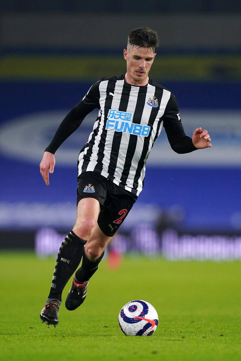 BRIGHTON, ENGLAND - MARCH 20: Ciaran Clark of Newcastle United runs with the ball during the Premier League match between Brighton & Hove Albion and Newcastle United at American Express Community Stadium on March 20, 2021 in Brighton, England. Sporting stadiums around the UK remain under strict restrictions due to the Coronavirus Pandemic as Government social distancing laws prohibit fans inside venues resulting in games being played behind closed doors. (Photo by John Walton - Pool/Getty Images)
