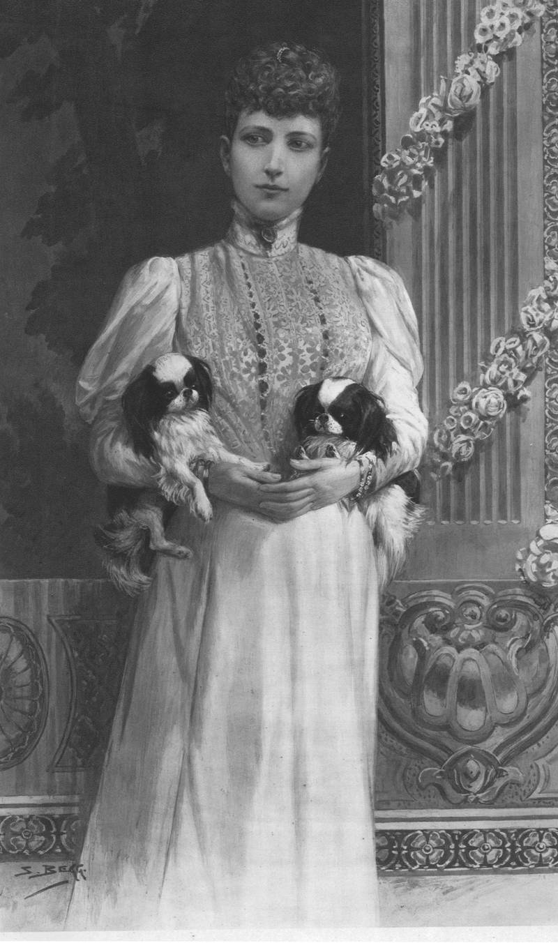 """Queen Alexandra', 1901. Portrait of Alexandra of Denmark (1844-1925) with two of her pet dogs. Her husband Edward Albert (1841-1910) became King Edward VII of the United Kingdom and Alexandra became Queen consort on the death of Queen Victoria on 22 January 1901. From """"The Illustrated London News Record of the Glorious Reign of Queen Victoria 1837-1901: The Life and Accession of King Edward VII. and the Life of Queen Alexandra"""". [London, 1901]. Artist Unknown. (Photo by The Print Collector via Getty Images)"""