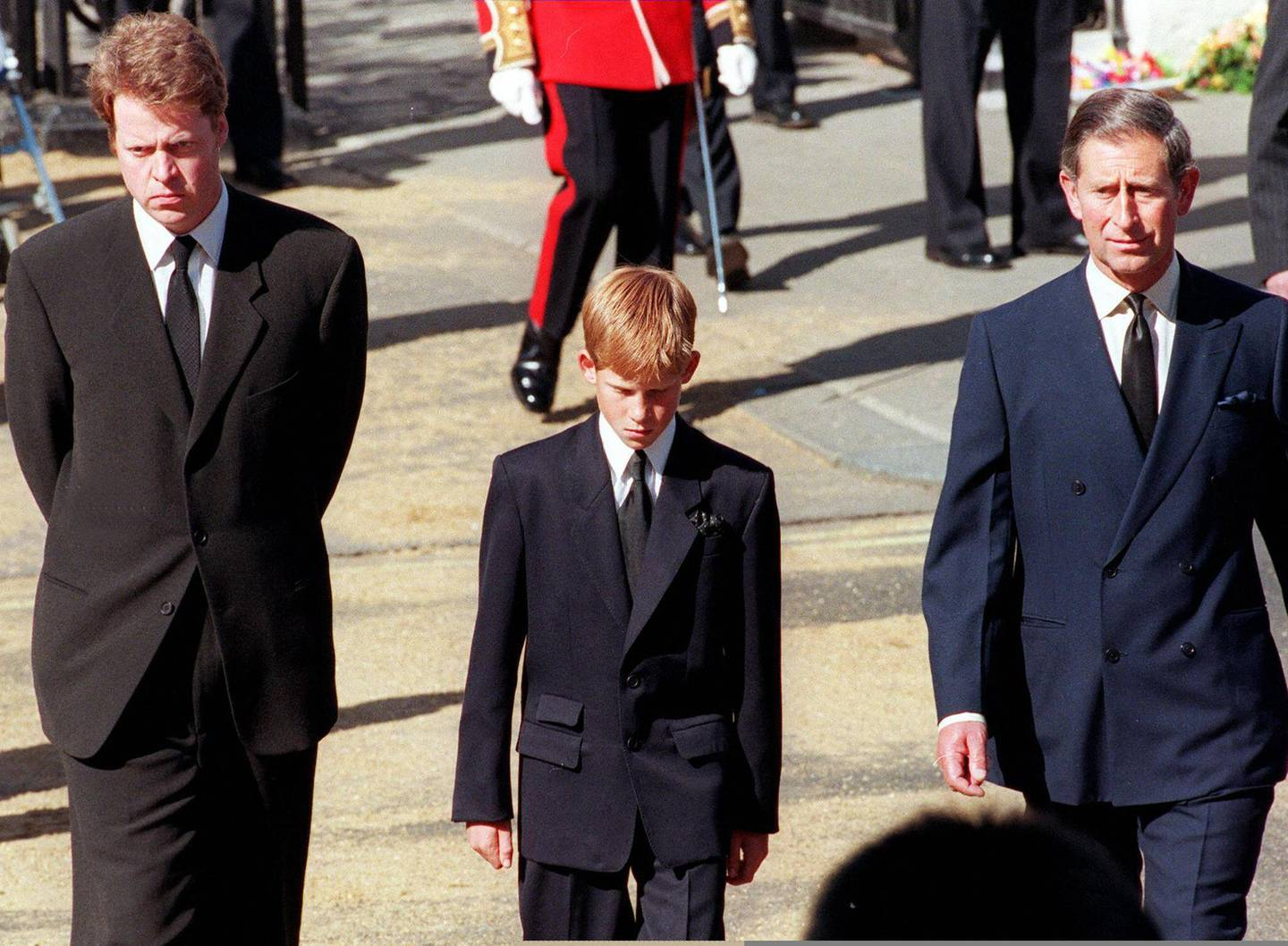 (FILES) In this file photo taken on September 06, 1997 (L to R) Earl Spencer, Diana's brother, Prince Harry, her son, and Prince Charles, her former husband, join the gun carriage carrying the coffin of Princess of Wales at Marlboro Road in London during the funeral. Scarred by the death of his mother, Prince Harry has struggled in the royal limelight for much of his life, and his fears for wife Meghan have now put him at loggerheads with his family. / AFP / Gerry PENNY