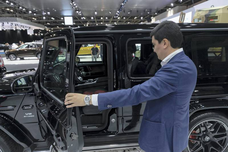 DUBAI, UNITED ARAB EMIRATES. 12 November 2019. Ulugbekhon Maksumov, Ceo of Inkas Vehicle LLC shows off one of their civilian models. Dubai Motor Show opening day. (Photo: Antonie Robertson/The National) Journalist: Nic Webster. Section: National.