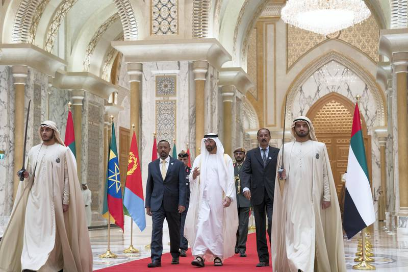 ABU DHABI, UNITED ARAB EMIRATES - July 24, 2018: HH Sheikh Mohamed bin Zayed Al Nahyan Crown Prince of Abu Dhabi Deputy Supreme Commander of the UAE Armed Forces (C), receives HE Dr Abiy Ahmed, Prime Minister of Ethiopia (2nd L) and HE Isaias Afwerki, President of Eritrea (2nd R), at the Presidential Palace.   ( Mohamed Al Hammadi / Crown Prince Court - Abu Dhabi ) ---