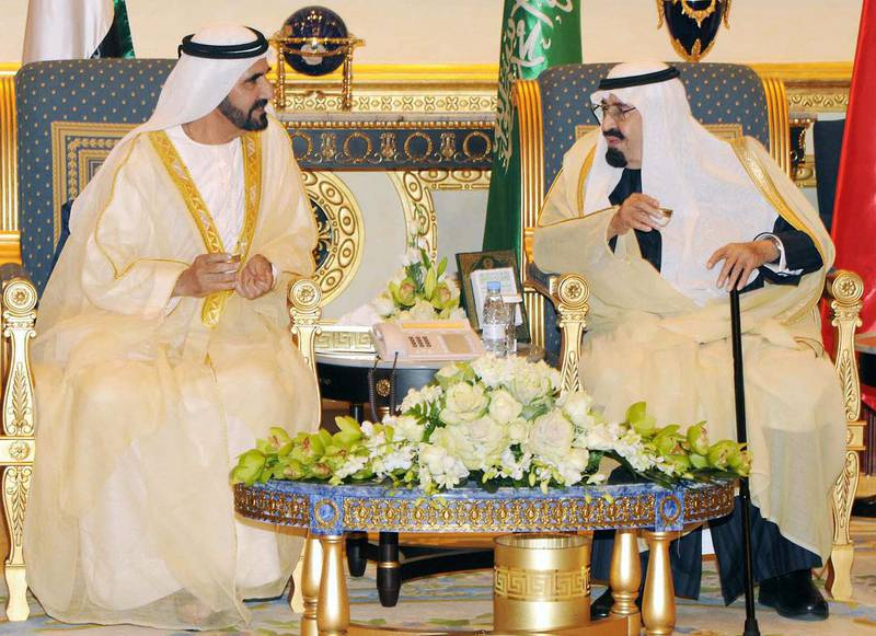 """In this handout picture released by the official Saudi Press Agency (SPA), Saudi Arabia's King Abdullah bin Abdul Aziz (R) meets with Sheikh Moammed bin Rashid al-Maktoum, ruler of Dubai and Prime Minister of the Untied Arab Emirates, on the sidelines of the Gulf Cooperation Council (GCC) summit meeting in Riyadh on December 19, 2011. The monarchs of the six Gulf nations are holding their first annual summit since the Arab Spring overthrew a raft of regional governments, including key allies  AFP PHOTO/HO/RESTRICTED TO EDITORIAL USE - MANDATORY CREDIT """" AFP PHOTO / SPA """" - NO MARKETING NO ADVERTISING CAMPAIGNS - DISTRIBUTED AS A SERVICE TO CLIENTS (Photo by - / SPA / AFP)"""