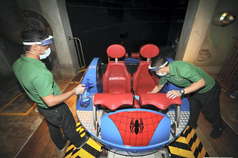 Dubai, United Arab Emirates - Reporter: N/A. Covid-19/Coronavirus. Sarfarag (L) and Surya clean the Spiderman ride. IMG World of Adventure opened on recently to the public with strict Covid-19/Coronavirus safety measures. Tuesday, July 21st, 2020. Dubai. Chris Whiteoak / The National