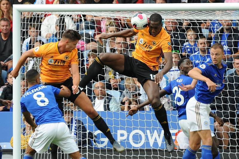 Wolverhampton Wanderers' Leander Dendoncker, top left, scores a goal that was disallowed during the English Premier League soccer match between Leicester City and Wolverhampton Wanderers at the King Power Stadium in Leicester, England, Sunday, Aug.11, 2019. (AP Photo/Rui Vieira)
