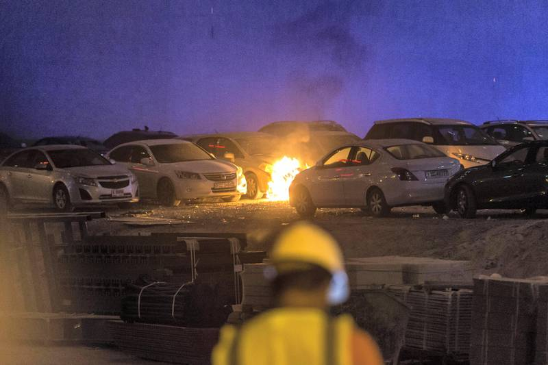 DUBAI. UNITED ARAB EMIRATES, 04 AUGUST 2017. A massive fire rips through The Marina Torch tower's southern corner. Flaming debris falls in an adjacent informal car park next to the building setting parked cars on fire. (Photo: Antonie Robertson) Journalist: None. Section: National.
