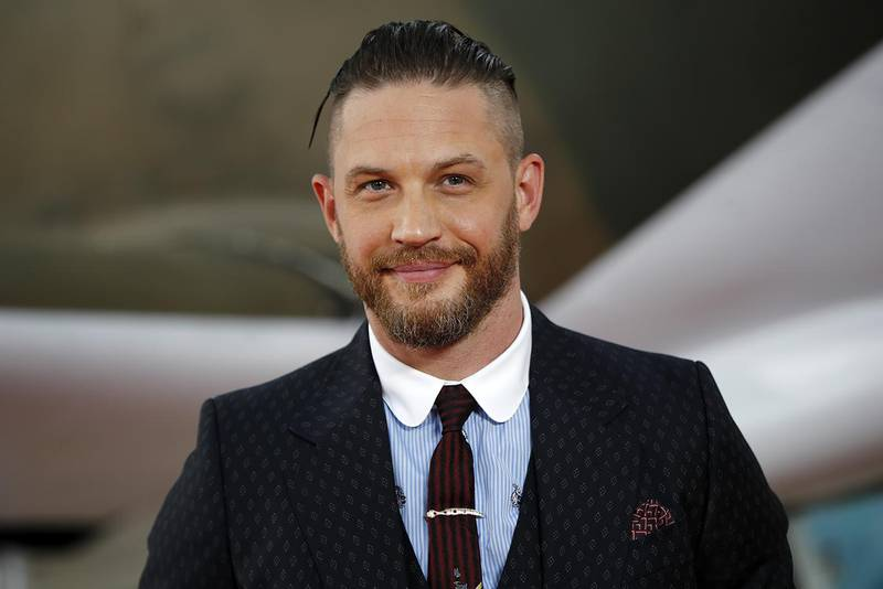 """British actor Tom Hardy poses for a photograph upon arrival for the world premiere of """"Dunkirk"""" in London on July 13, 2017. (Photo by Tolga AKMEN / AFP)"""