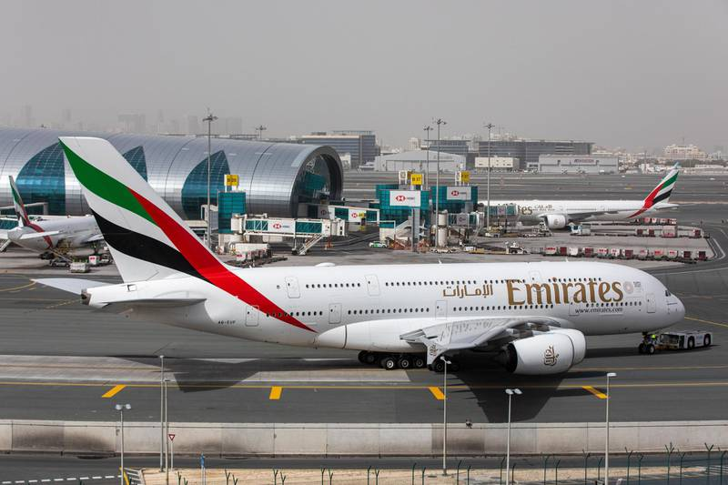 An Airbus SE A380-800 aircraft, operated by Emirates, taxis past the terminal at Dubai International Airport in Dubai, United Arab Emirates, on Monday, March 23, 2020. Dubai-basedEmirates, the largest long-haul airline, and neighbor Etihad of Abu Dhabi will stop flying passengers for two weeks from Wednesday because of local restrictions. Photographer: Christopher Pike/Bloomberg