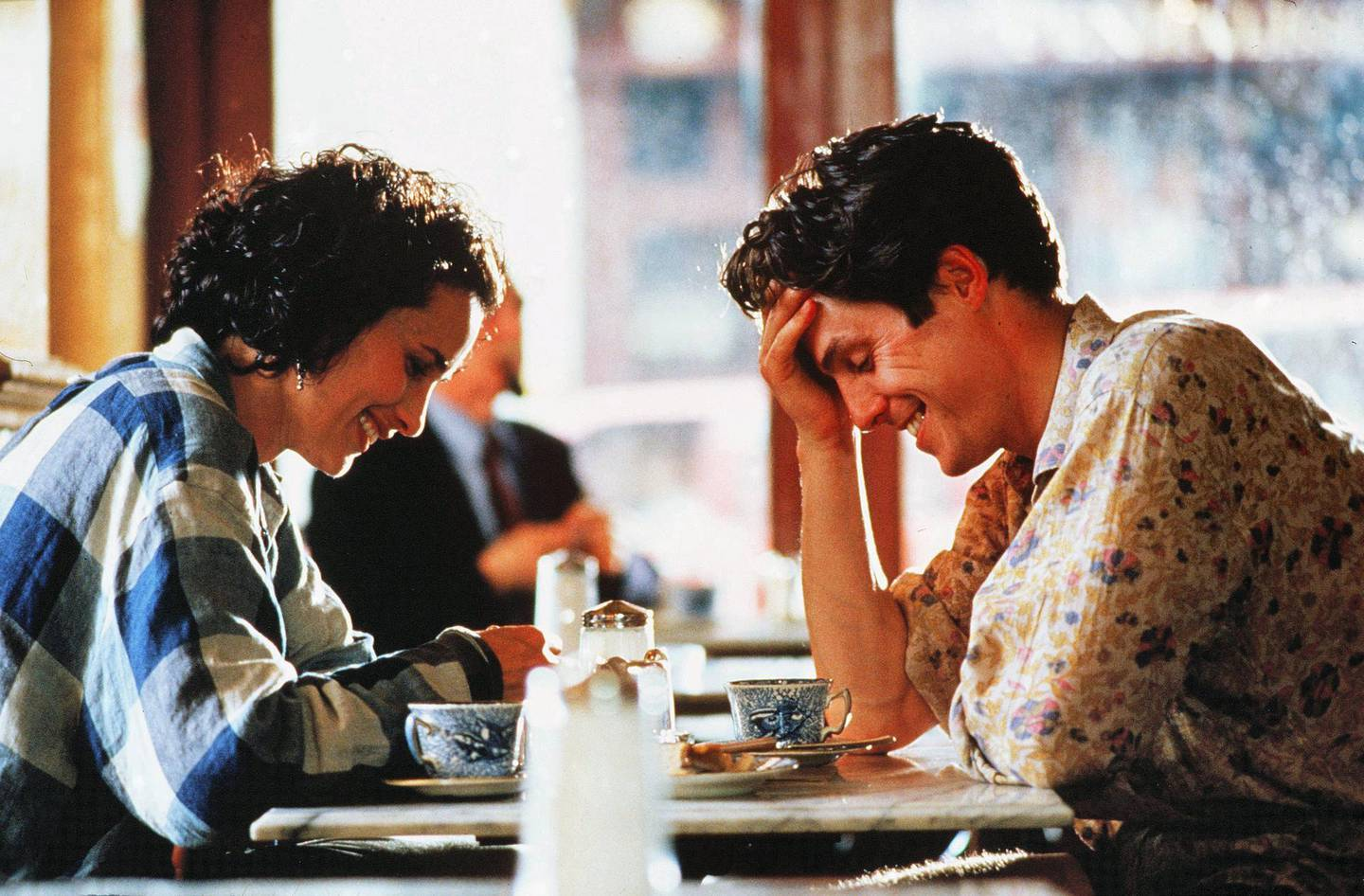 Editorial use only. No book cover usage.Mandatory Credit: Photo by Stephan F Morley/Polygram/Working Title/Kobal/Shutterstock (5884693e)Andie Macdowell, Hugh GrantFour Weddings and A Funeral - 1994Director: Mike NewellPolygram/Channel 4/Working TitleBRITAINScene StillComedyQuatre mariages et un enterrement