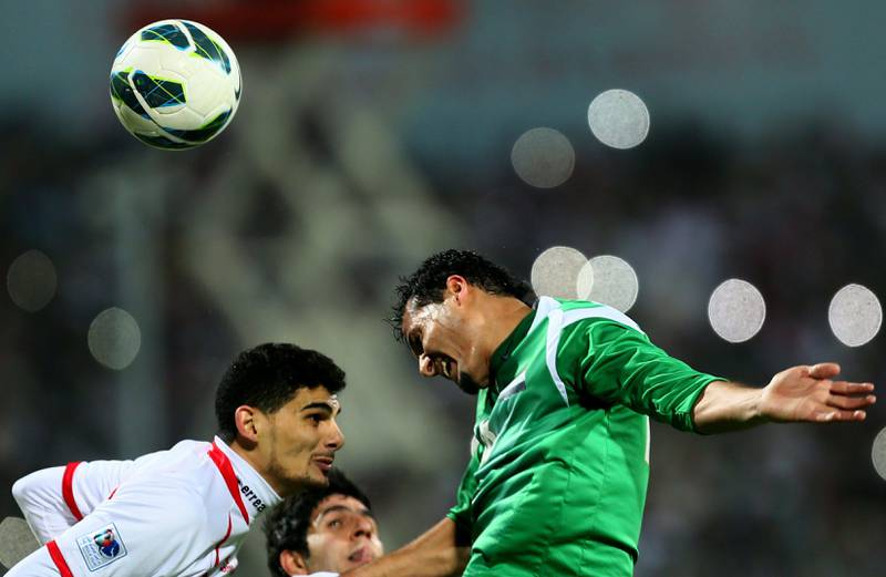 Hussam al-Sarry (R) of Iraq vies with Mohannad Salem of UAE as he attempts to score during the 21st Gulf Cup's final between United Arab Emirates (UAE) and Iraq on January 18, 2013 in Manama. United Arab Emirates won 2-1 against  Iraq.  AFP PHOTO/MARWAN NAAMANI  *** Local Caption ***  291256-01-08.jpg