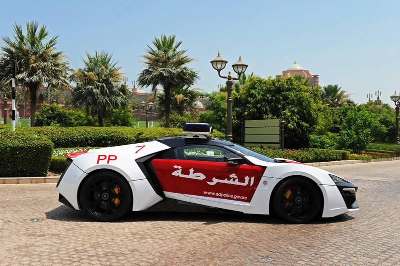 June 5, 2015- Abu Dhabi Police will  use the Lykan HyperSport supercar to increase traffic awareness among the public.  The supercar, made on a limited production by the Lebanese company W Motors with an Arabian touch and flavour, is the first unit of a total seven and costs $3.5 million (about Dh12.8 million).  Abu Dhabi Police plan to display the car soon in tourist areas and shopping malls in Abu Dhabi. The car appears in Furious 7 which was partly filmed in Abu Dhabi.  Courtesy Security Media *** Local Caption ***  on05ju-lykan1.JPG