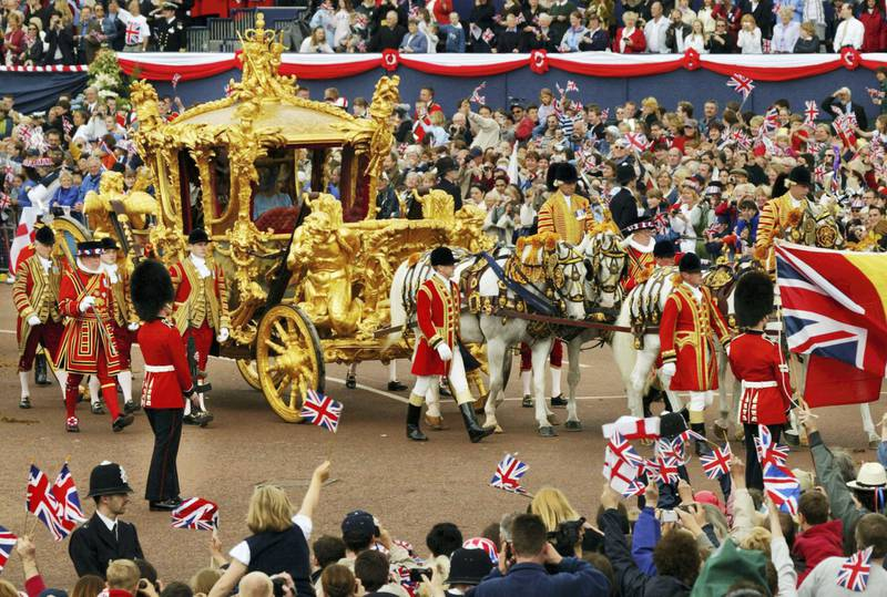 406180 04:  Britain's Queen Elizabeth (R) and Prince Philip ride in the Golden State Carriage at the head of a parade from Buckingham Palace to St Paul's Cathedral celebrating the Queen's Golden Jubilee June 4, 2002 along The Mall in London.  (Photo by Sion Touhig/Getty Images)