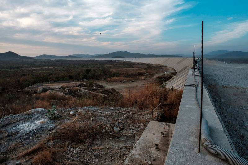 """(FILES) In this file photo taken on December 27, 2019 a general view of the Saddle Dam, part of the Grand Ethiopian Renaissance Dam (GERD), Ethiopia, near Guba in Ethiopia. The United States is optimistic Ethiopia is close to a deal with Egypt and Sudan on a controversial mega-dam, an official said February 10, 2020, ahead of a trip by Secretary of State Mike Pompeo. Pompeo will visit Ethiopia as well as Senegal and Angola starting on Saturday on his first visit to sub-Saharan Africa since becoming the top US diplomat in April 2018. Asked if Pompeo would seek to seal an accord in US-brokered talks on the dam, a senior US official said: """"Hopefully that situation is close to resolution.""""  / AFP / EDUARDO SOTERAS"""