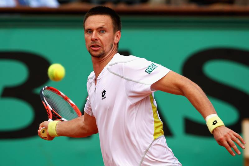 PARIS - MAY 31:  Robin Soderling of Sweden hits a forehand during the Men's Singles Fourth Round match against Rafael Nadal of Spain on day eight of the French Open at Roland Garros on May 31, 2009 in Paris, France.  (Photo by Clive Brunskill/Getty Images)