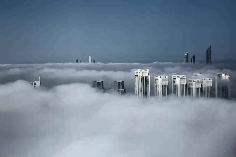 April 22, 2015, Abu Dhabi, UAE - Fog in Abu Dhabi this moring  seen from The Gate Towers on Reem Island.   Irene García León  for  The National *** Local Caption ***  na22ap-fog_standalone.jpg