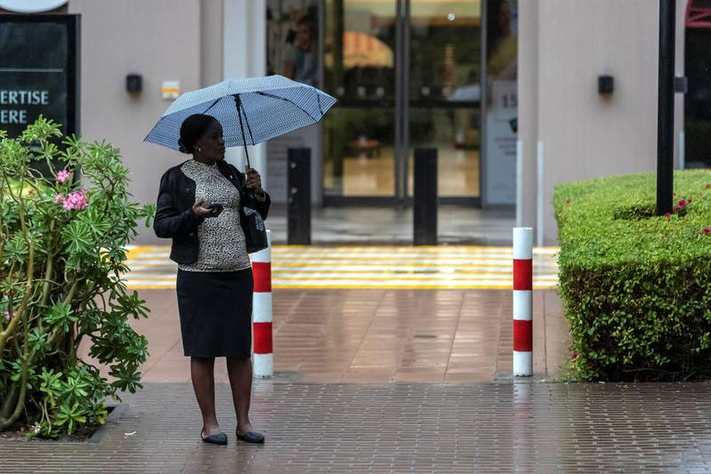 DUBAI, UNITED ARAB EMIRATES. 10 JANUARY 2020. Heavy rains in Dubai during the night had residenst wake up to wet pavements and large water puddles with some areas experiencng mild flooding. Residents of The Greens got out their umbrellas today for their morning walk. (Photo: Antonie Robertson/The National) Journalist: Standalone. Section: National.