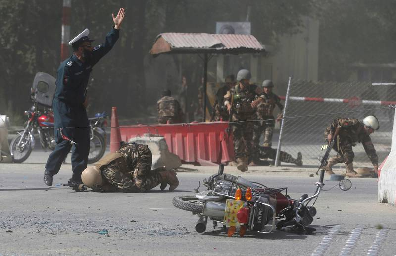 REFILE - QUALITY REPEAT  Afghan security forces are seen at the site of a second blast in Kabul, Afghanistan April 30, 2018. REUTERS/Omar Sobhani